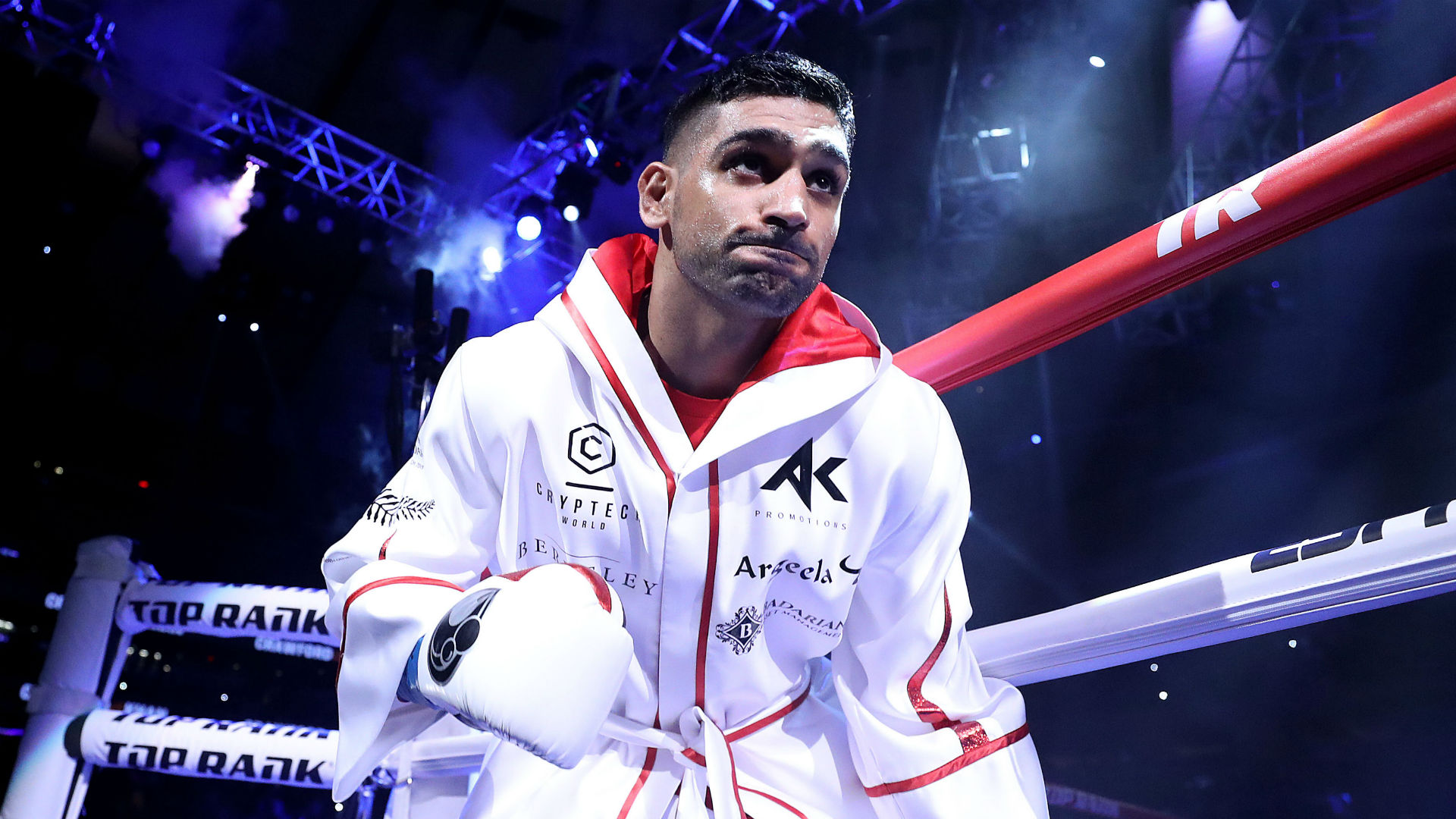 Khan will not retire on Crawford loss