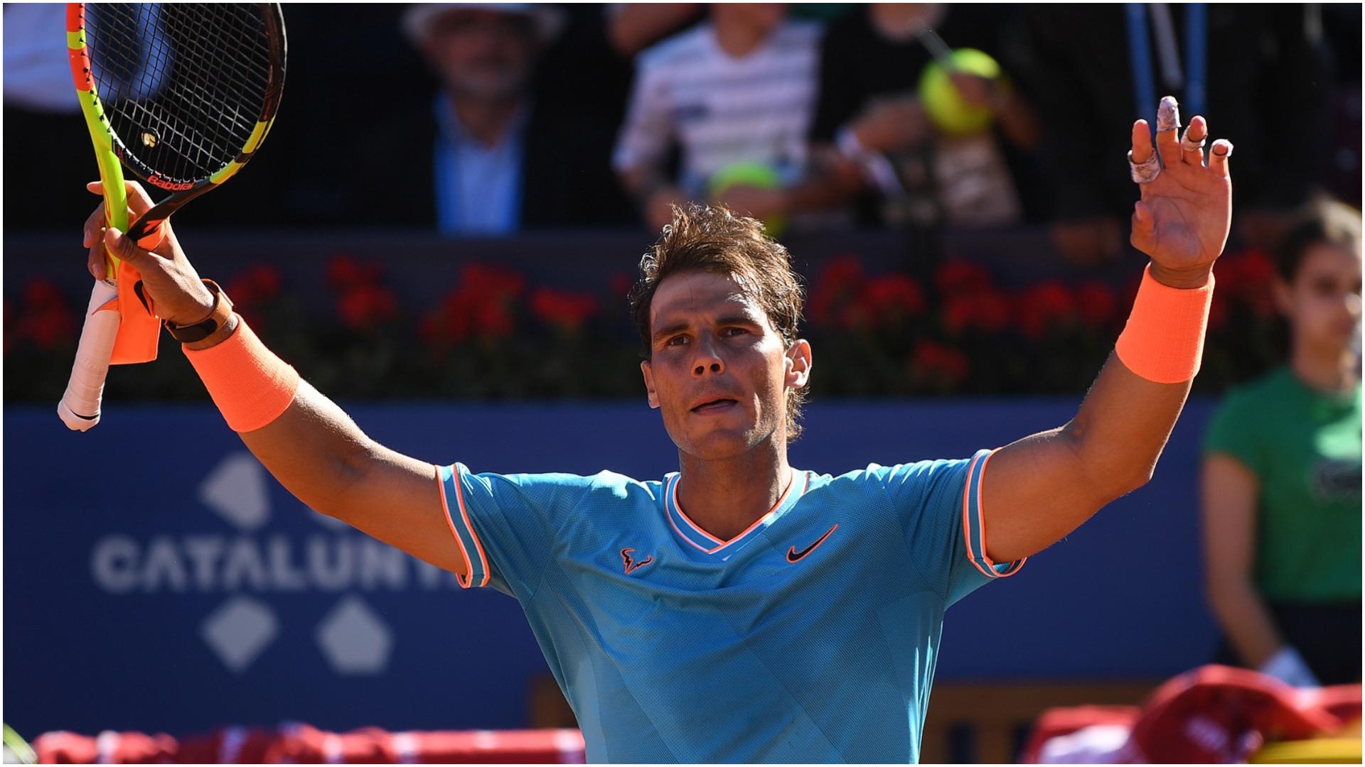Nadal overcomes Ferrer and rain in Spain