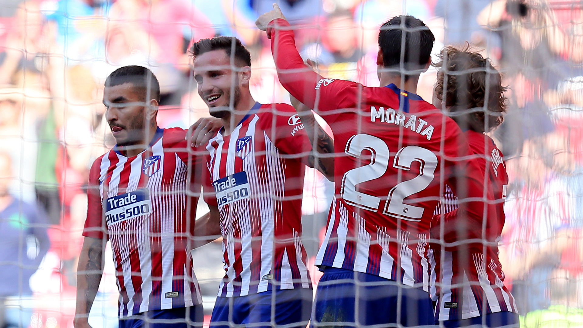 Atletico Madrid 1 Real Valladolid 0: Joaquin own goal keeps Barcelona waiting