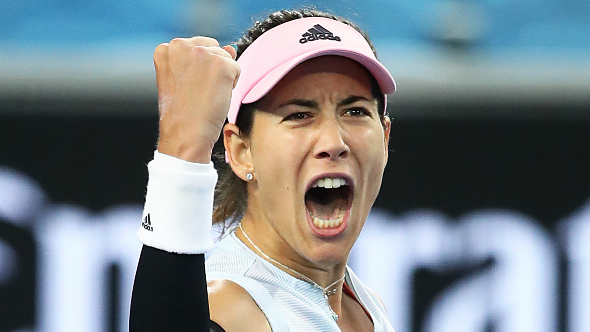 Muguruza defends Monterrey crown after Azarenka retires