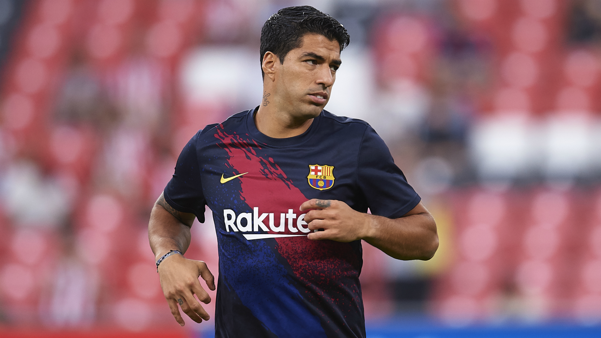 Suarez off injured in Barcelona's opening LaLiga match