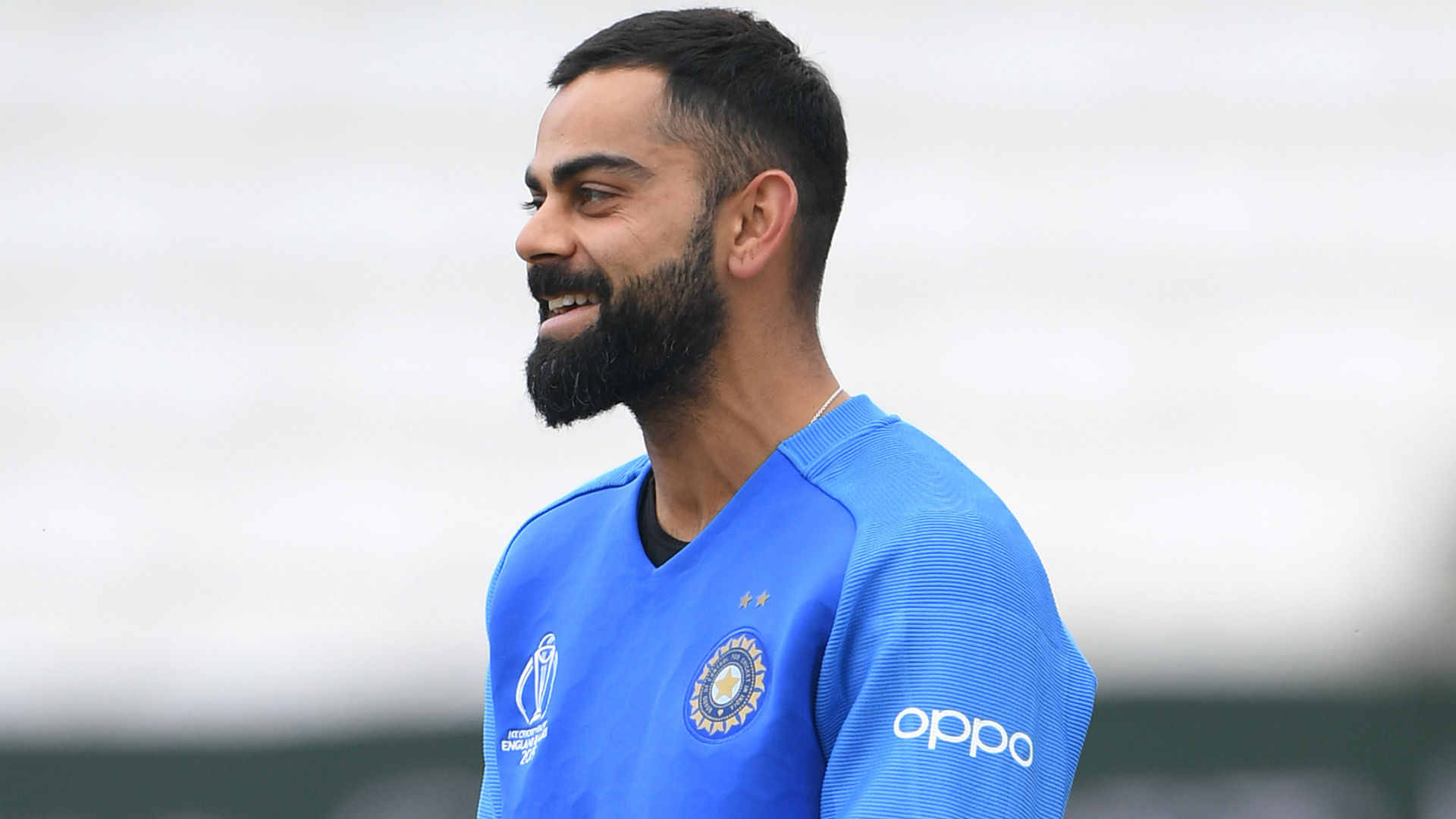 A few words but smiles at the end - Kohli laughs off notebook celebration