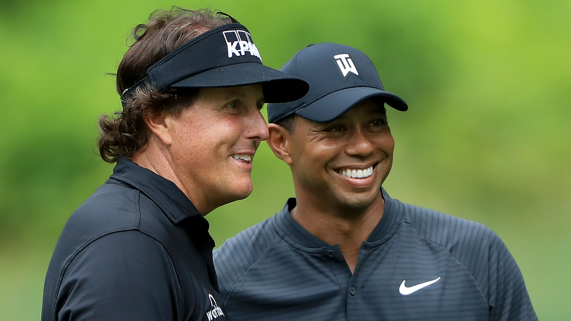 Tiger motivated by Mickelson's success