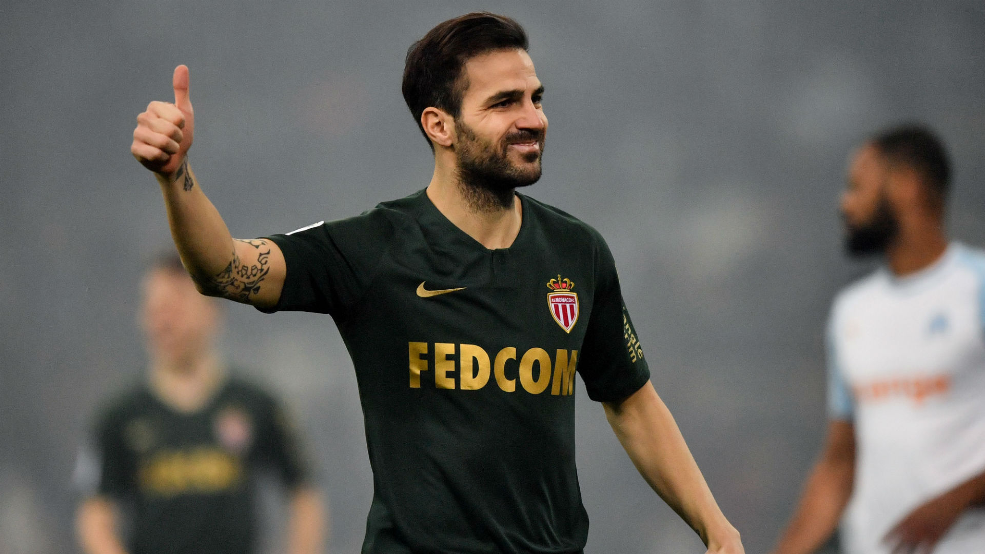 Henry positive after Fabregas helps Monaco to debut draw