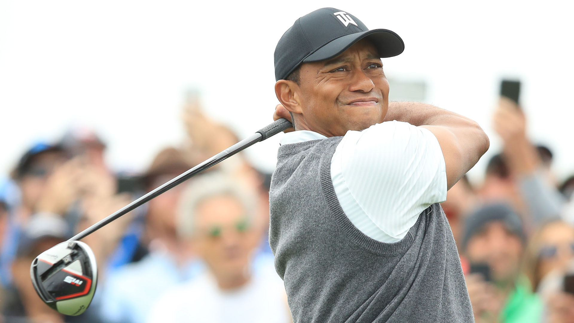 Tiger scratches, claws way to one-under 70