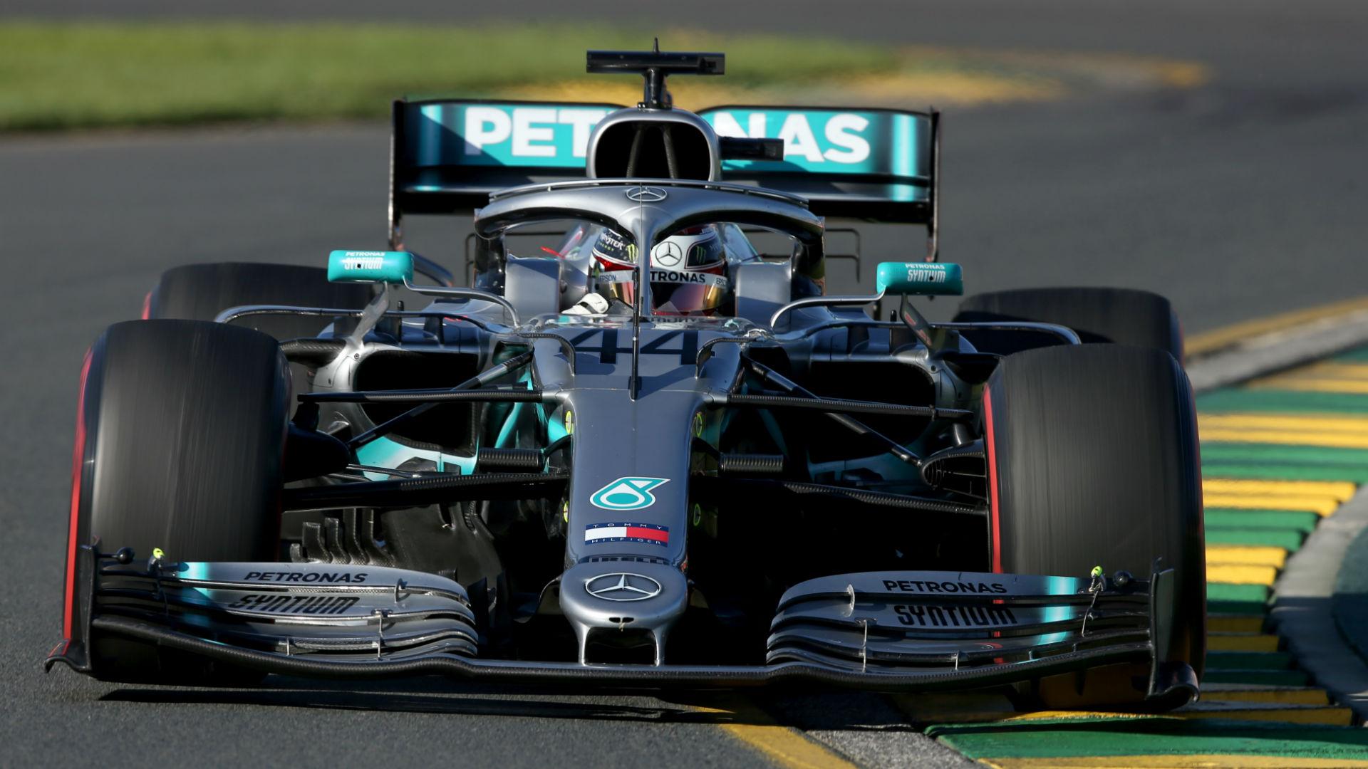 Hamilton feels 'positive buzz' as he sets Melbourne pace