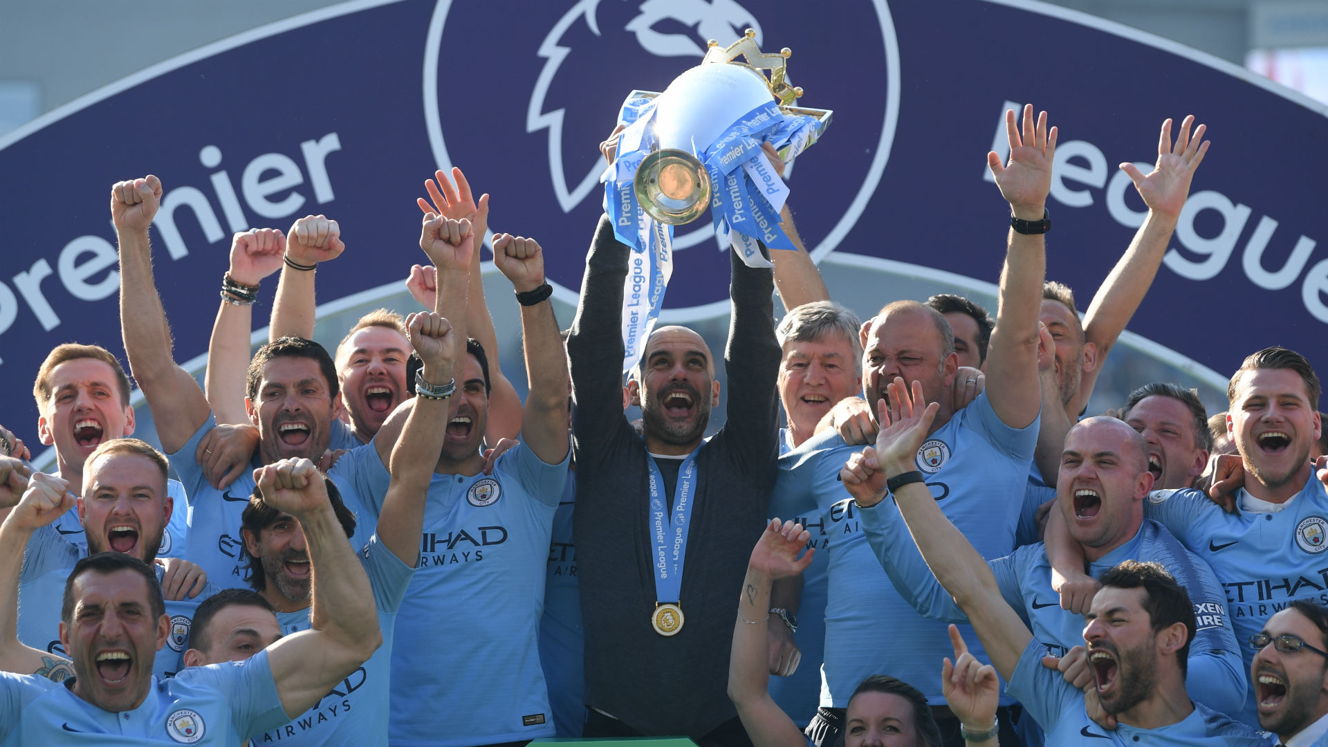 Guardiola celebrates toughest title after City see off Liverpool