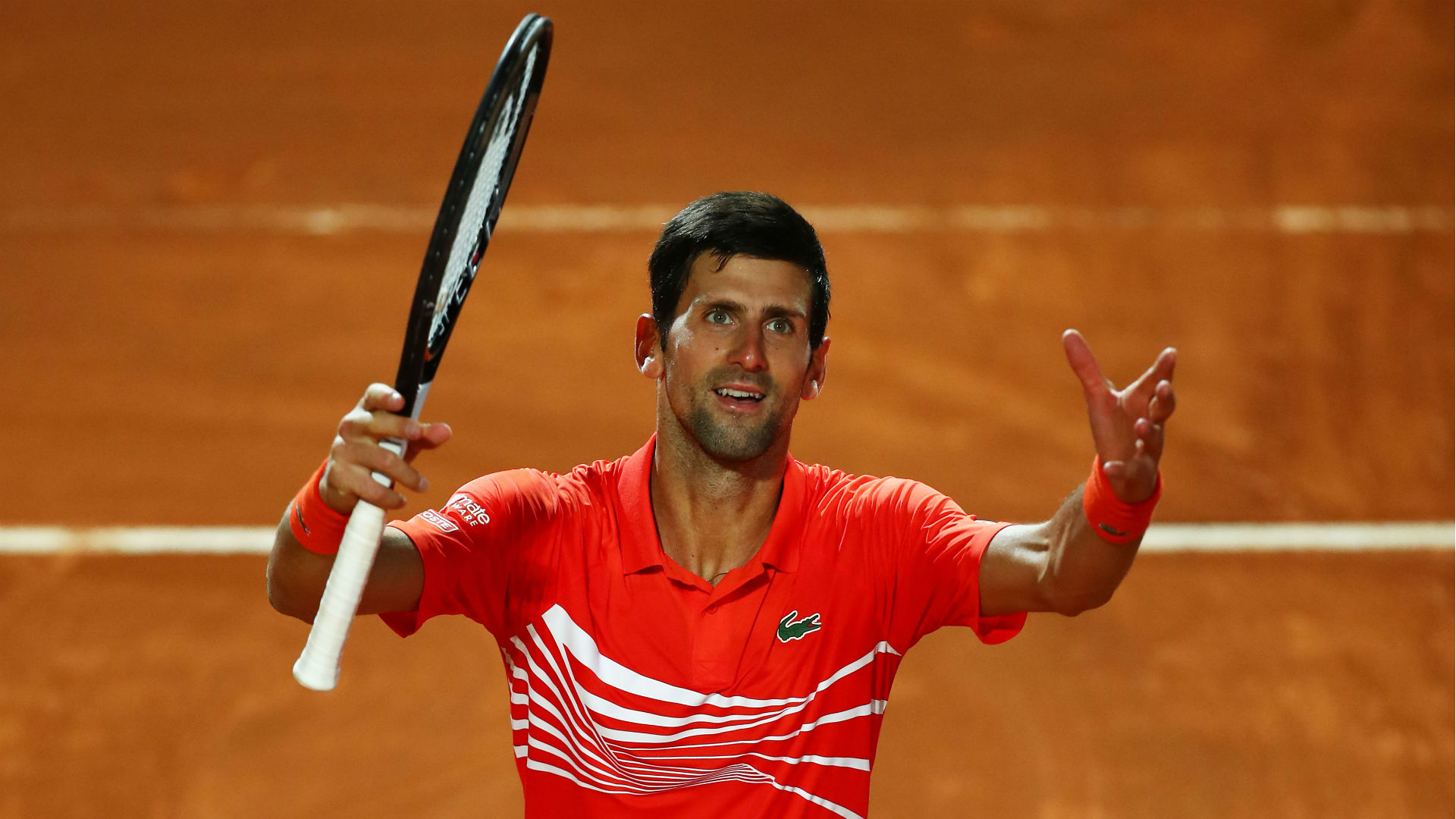 Djokovic edges out Schwartzman to set up Nadal final