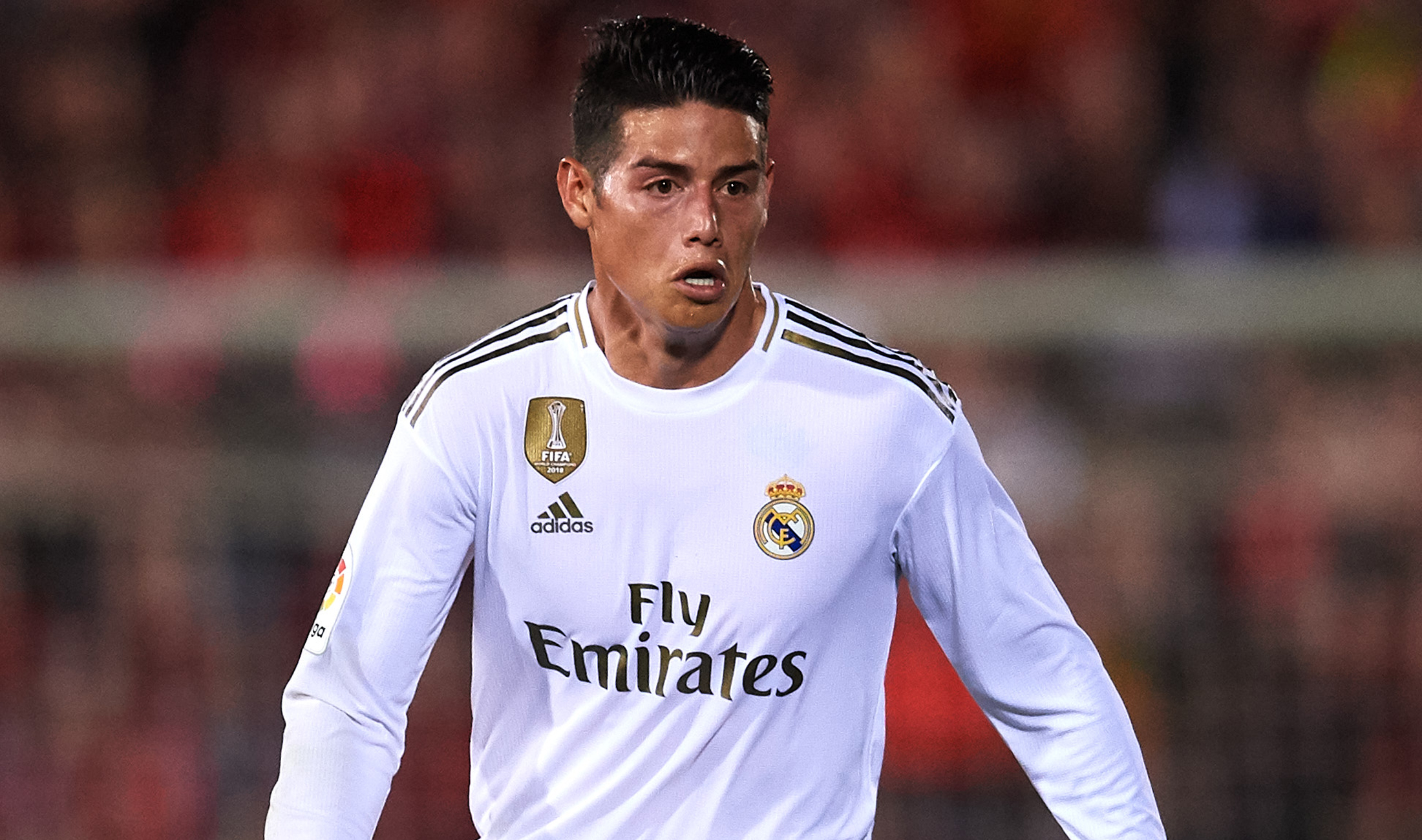 Real Madrid midfielder James suffers knee injury in Colombia training