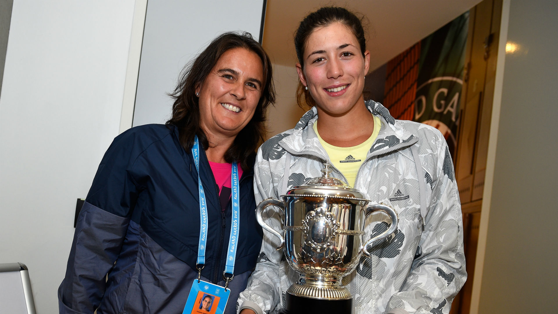 Muguruza reunites with coach Martinez