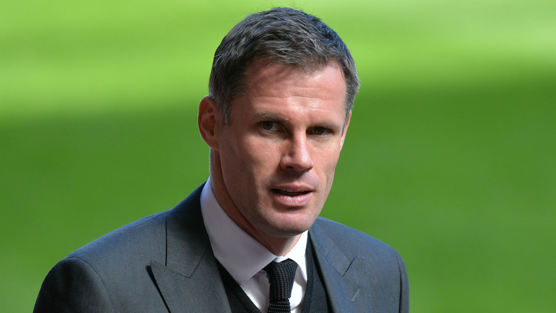 Carragher apologises to Evra for t-shirts worn in support of Suarez