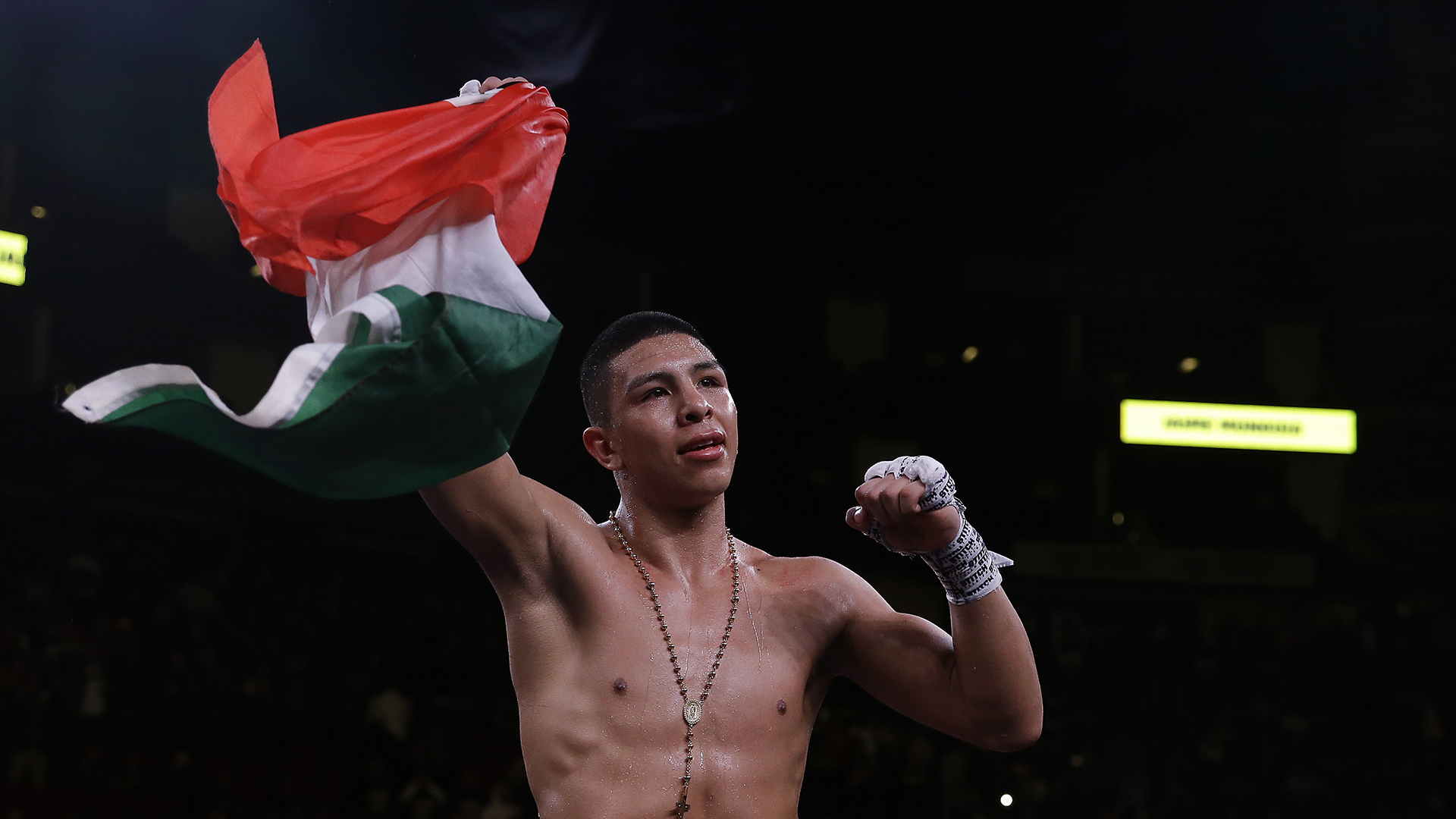 Munguia retains title with TKO of Allotey