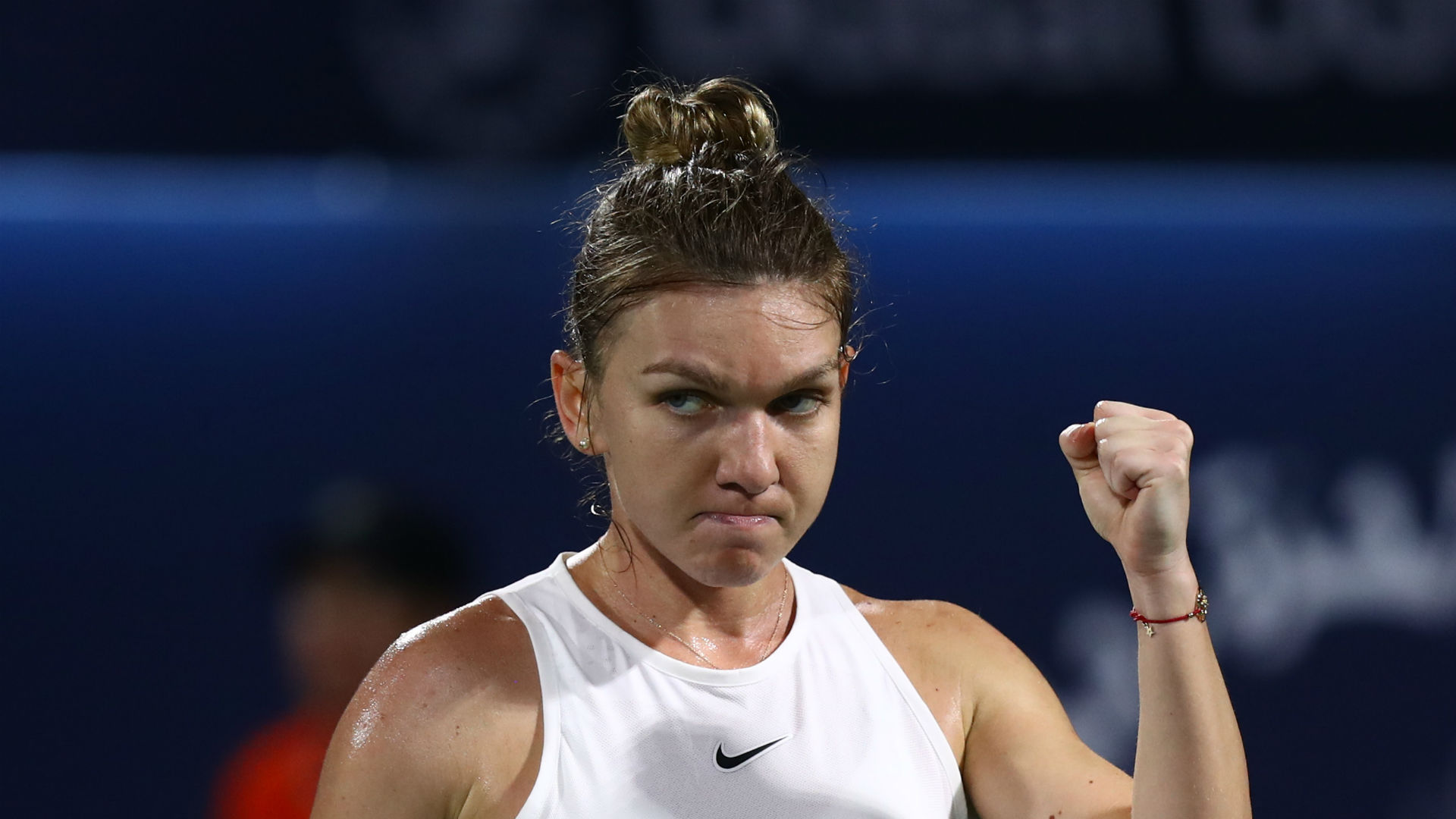 Halep edges out Hercog on WTA Tour return in Prague