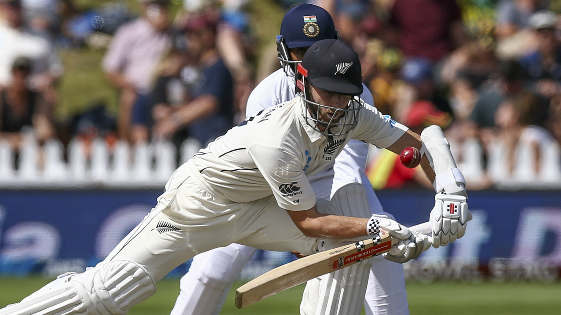 Williamson's New Zealand earn lead but India strike back with late wickets