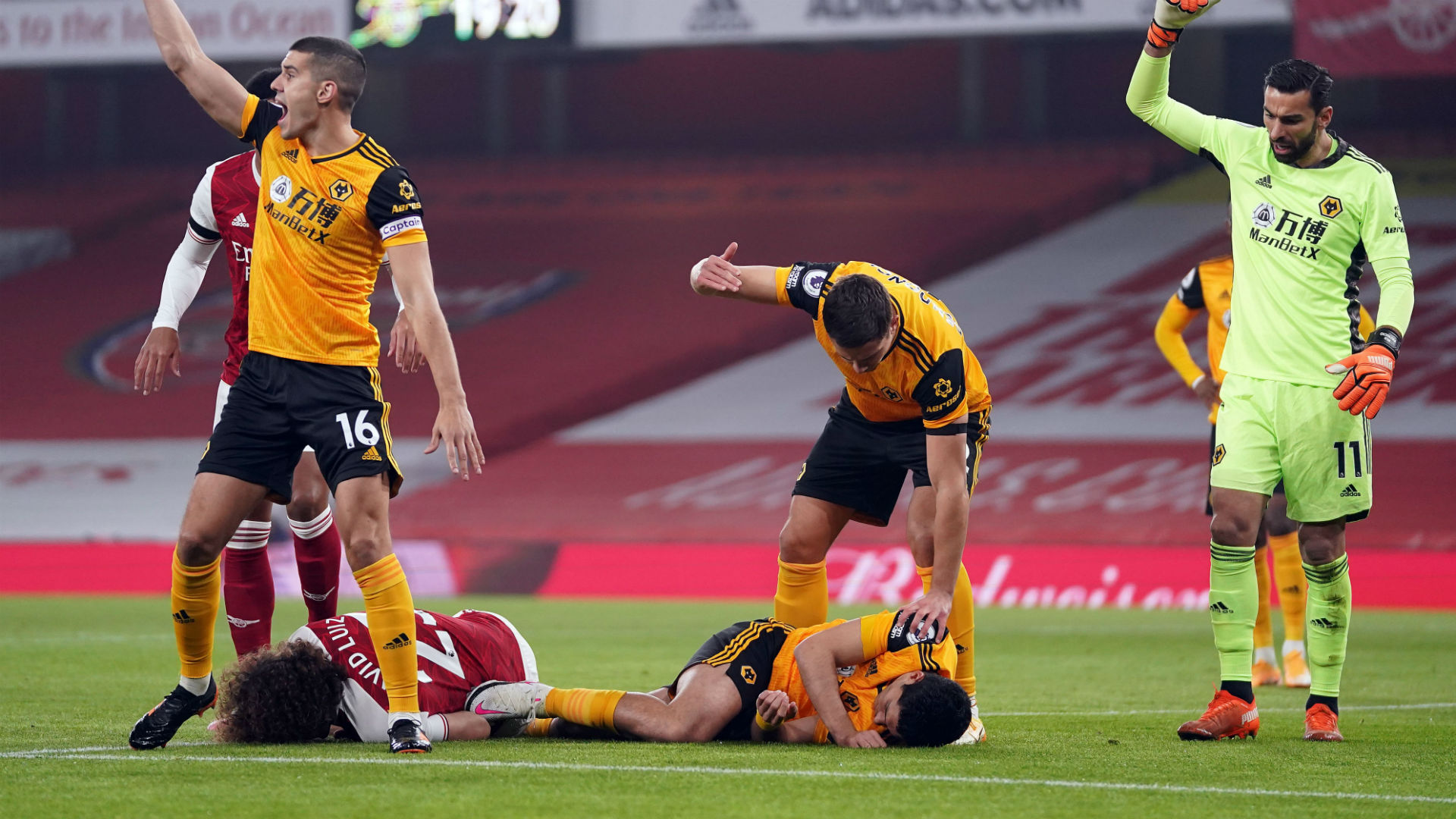 Wolves striker Jimenez conscious in hospital after head injury