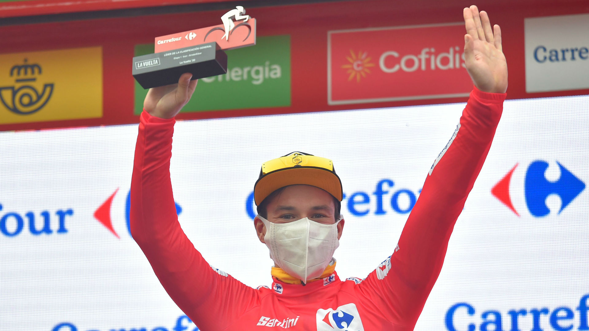 Vuelta a Espana: Roglic begins red jersey defence with victory