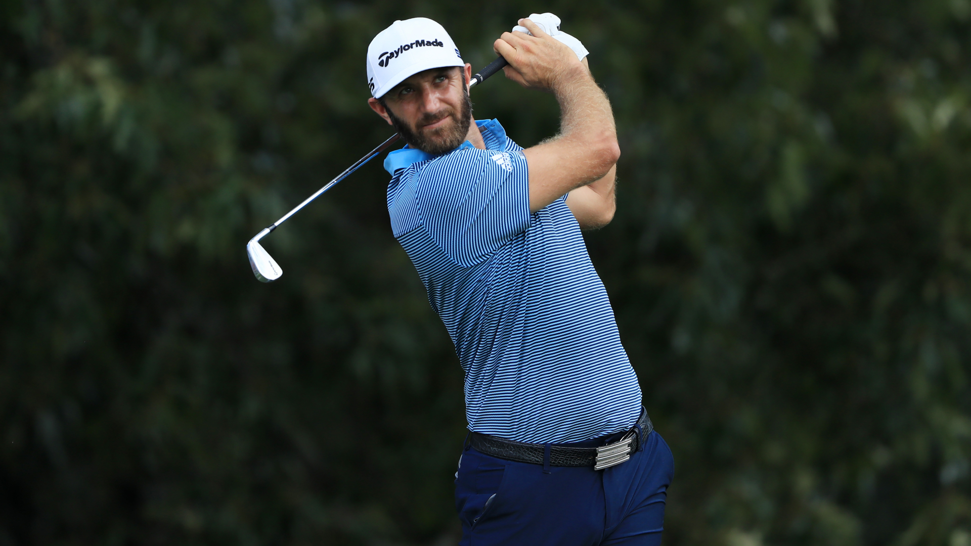 Johnson, Rahm share lead as McIlroy charges into contention